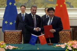 Miao Wei, Minister of Industry and Information Technology, with Günther Oettinger, EU Commissioner for Digital Economy & Society, shake hands after signing the 5G Agreement between the EU and China.