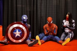 Attendees dressed as Marvel's Captain Spidey, left, Spiderman, center, and Silk take a break during the D23 Expo 2015 in Anaheim, California, U.S., on Friday, Aug. 14, 2015.