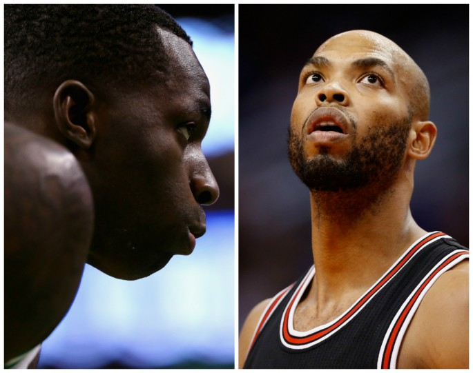 Los Angeles Lakers' Brandon Bass (L) and Chicago Bulls' Taj Gibson.