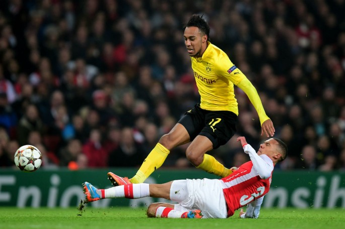 Pierre-Emerick Aubameyang of Borussia Dortmund is tackled by Kieran Gibbs of Arsenal during their UEFA Champions League Group D match.