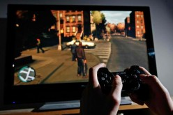 A young man plays Grand Theft Auto IV on the game's day of release on April 29, 2008 in London, England.
