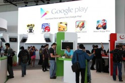 Attendees visit the Google Play booth during the Google I/O developers conference at the Moscone Center on May 15, 2013 in San Francisco, California.