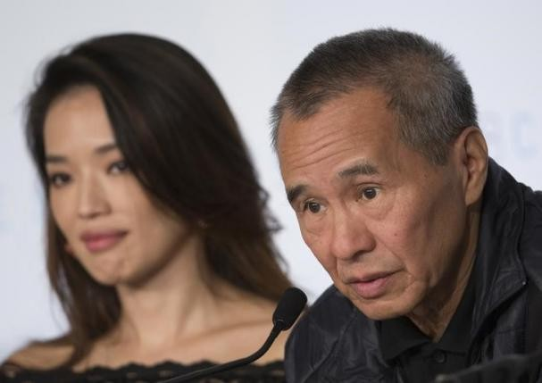 "Director Hou Hsiao-hsien and actress Shu Qi attend a news conference for the film ""The Assassin"" at the 68th Cannes Film Festival in this May 21, 2015 photo."