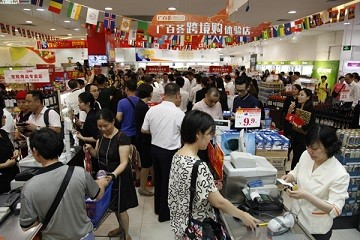 Shoppers buy products at a Guangzhou Grandbuy store, the largest department-store chain in the city.