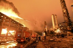 Firefighters try to extinguish a fire in Zhangzhou, Fujian Province, after an explosion hit part of an oil storage facility owned by Dragon Aromatics, in this April 7, 2015 photo.