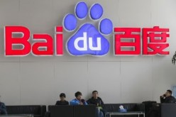 Visitors sit at the lobby of Baidu headquarters in Beijing.