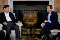 British Prime Minister David Cameron (R) holds talks with Chinese President Xi Jinping at his official residence at Chequers on Oct. 22, 2015, in Aylesbury, England.