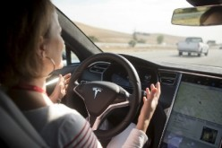 A driver tests Tesla's auto-pilot software, the Version 7.0.