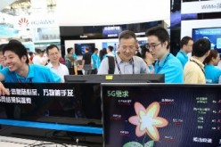 Spectators take a look at the 5G technology during the Mobile World Congress in Shanghai in July.