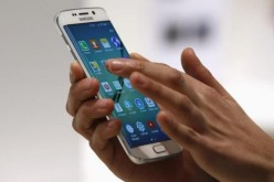 A hostess displays Samsung Galaxy S6 Edge smartphone during the Mobile World Congress.