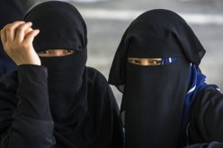 Windows of the soul: Only the eyes and some skin are made visible by the burqa, also called paranja or chadri, worn by these women.