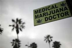 A sign advertises a medical marijuana dispensary on Venice Beach in Los Angeles, California