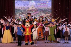 Mickey Mouse joins other Disney characters and a children's choir during the official groundbreaking ceremony for the Shanghai Disney Resort in Shanghai, China, April 8, 2011.