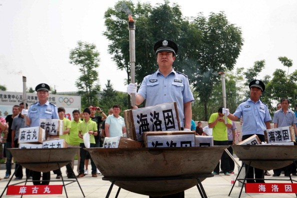 Policemen prepare to incinerate drugs on the International Day Against Drug Abuse and Illicit Trafficking, in Shenyang, on June 26, 2012.