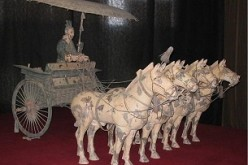A bronze chariot owned by the First Emperor of China on display in a museum.