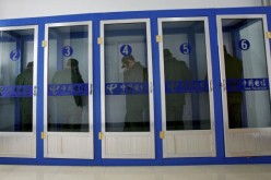 New recruits make phone calls at a military training base in Xining, Qinghai Province, China, on Jan. 13, 2007.