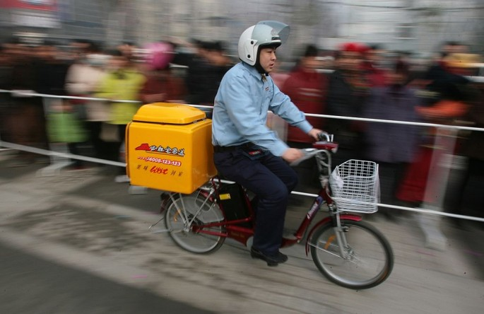 A delivery guy rides his bicycle in Nanjing, Jiangsu Province, on Jan. 18, 2007.