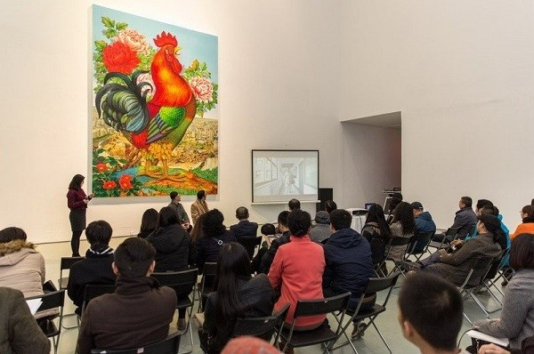 Visitors attending the opening gala watch a video presentation. Lu Shengzhong (in front, middle) joins them.
