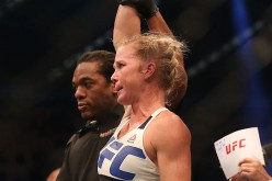 Holly Holm celebrates victory over Ronda Rousey in their UFC women's bantamweight championship bout during the UFC 193 event at Etihad Stadium on November 15, 2015 in Melbourne, Australia.