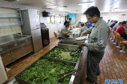 Team members have a meal aboard the icebreaker Xuelong on Nov 8, 2015.