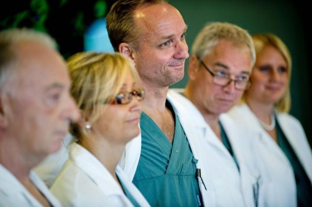 Professor Mats Brannstrom (C), head of a medical team which performed its first uterus transplant on a patient, attends a news conference