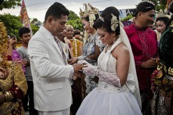 According to documents issued by the county's Party committee on Sunday, if both partners were previously married and divorced, they are not allowed to host a wedding party.