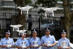 Law enforcers try to control and fly drones in Shenzhen.