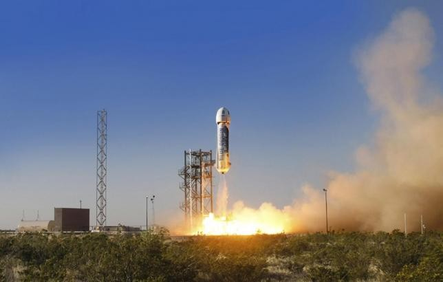 The New Shepard space vehicle blasts off on its first developmental test flight over Blue Origin's west Texas launch site in this handout provided by Blue Origin.