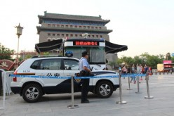An armed police officer stands guard at Qianmen in Beijing on May 12, 2014.