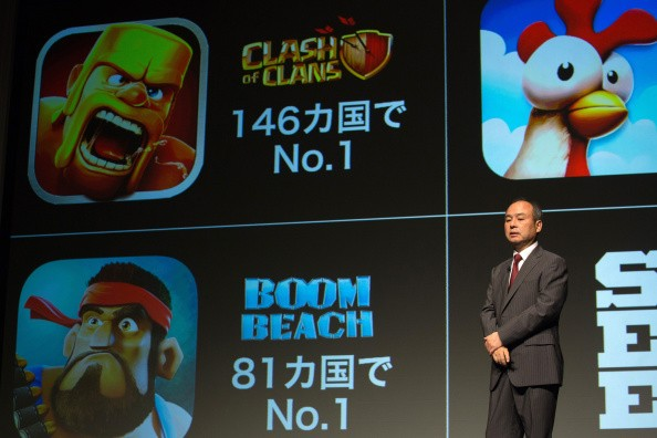Billionaire Masayoshi Son, chairman and chief executive officer of SoftBank Corp., speaks in front of mobile game images of Clash of Clans and Boom Beach by gamemaker Supercell Oy in Tokyo, Japan.
