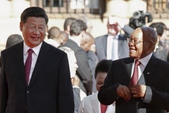President Xi Jinping is welcomed by South African President Jacob Zuma upon his arrival at the Union Buildings in Pretoria.
