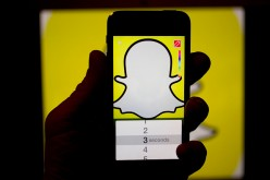 The Snapchat Inc. application (app) is displayed for a photograph on an Apple Inc. iPhone 5s in Washington, D.C., U.S., on Wednesday, Feb. 18, 2015.