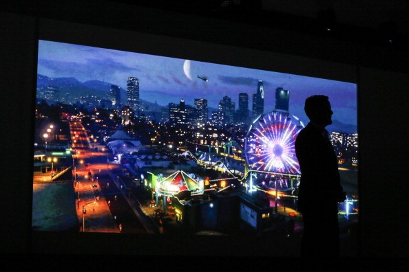 Andrew House, president and chief executive officer of Sony Computer Entertainment Inc., is silhouetted as he watches a trailer for the Grand Theft Auto Five (GTA 5) video game for PlayStation 4 (PS4) during the Sony Corp. media event