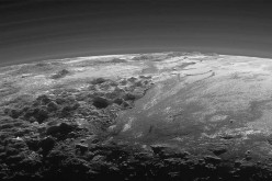 A close-up view of the rugged, icy mountains and flat ice plains on Pluto is seen in an image from NASA's New Horizons spacecraft taken July 14, 2015 and released Sept. 17, 2015.