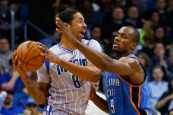 Orlando Magic power foward Channing Frye goes against Oklahoma City Thunder's Serge Ibaka.