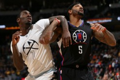 Los Angeles Clippers power forward Josh Smith (R) boxes out Denver Nuggets' JJ Hickson during a rebound battle.