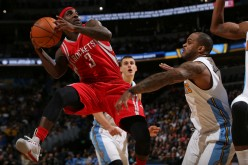 Houston Rockets point guard Ty Lawson tries to shoot over Denver Nuggets' Jameer Nelson.