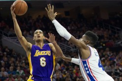 Los Angeles Lakers point guard Jordan Clarkson attempts a layup against Philadelphia 76ers' Nerlens Noel.
