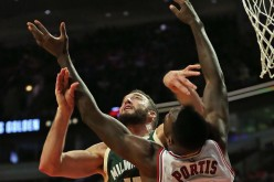 Milwaukee Bucks center Miles Plumlee rebounds against Chicago Bulls' Bobby Portis.
