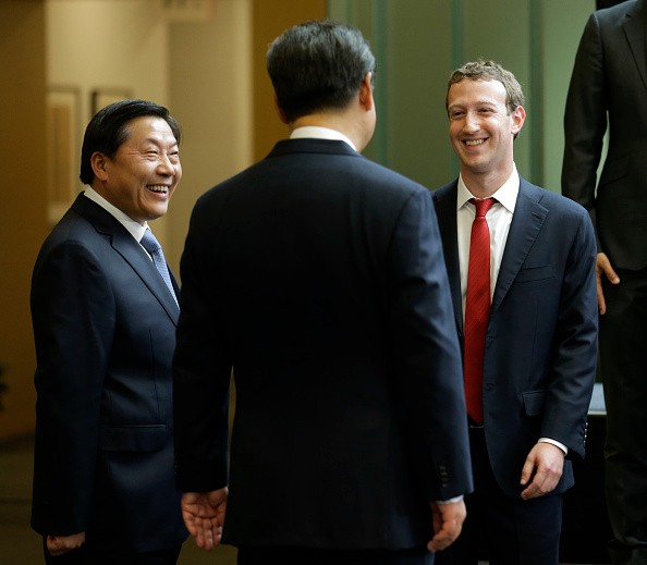 Chinese President Xi Jinping (C) talks with Facebook founder Mark Zuckerberg (R) as China's Internet czar Lu Wei looks on in this Sept. 23, 2015 photo.