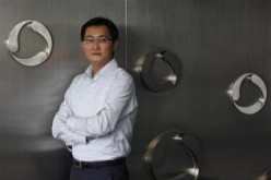 Tencent chairman and CEO Pony Ma poses at the company's headquarters in Nanshan Hi-Tech Industrial Park in the southern Chinese city of Shenzhen.