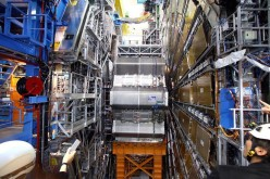 Scientists working at the Large Hadron Collider reported .signs of a possible new subatomic particle