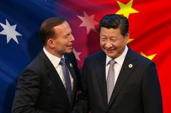Australian Prime Minister Tony Abbott shakes hand with President Xi Jinping during the signing of a free trade agreement in Canberra in June.
