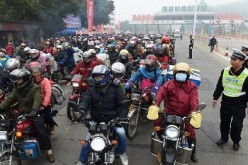 Many migrant workers prefer to use motorcycles as their mode of transport when they go home to their families in the provinces for the Chinese New Year.