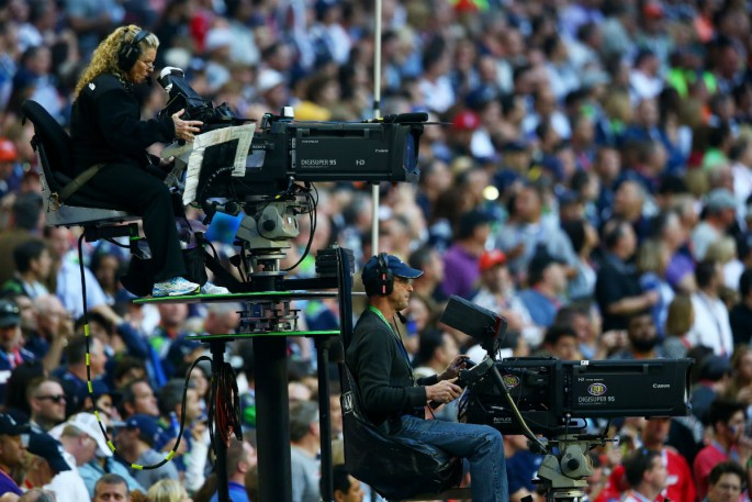 Local TV cameras cover Super Bowl XLIX between the New England Patriots and Seattle Seahawks.
