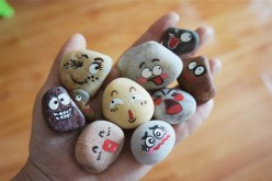 Stones painted with emojis are created by a primary school teacher from Shandong Province, Jan. 17, 2016.
