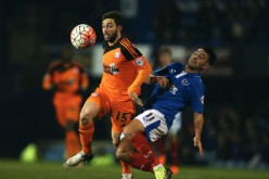 Australian midfielder Tommy Oar competes for the ball against Portsmouth's Gary Roberts during his recent stint with Ipswich Town.