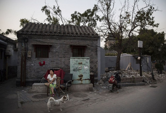 Part of the efforts is to move some people from one-story hutong houses in the districts of Xicheng and Dongcheng as a means to avoid further damage to architecture.