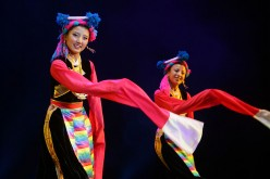 Members of a performance troupe from Sichuan Province perform Tibetan folk dance in Beijing, China, on June 14, 2008.