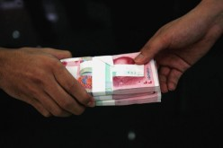 Prosecutors in Shanghai are cracking down on both the officials who received bribes and the people who handed them.